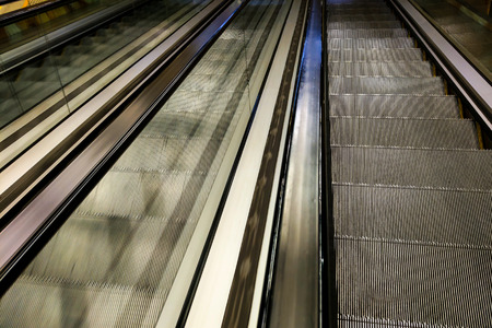 Modern walkway of escalator move forward and escalator move backward Фото со стока