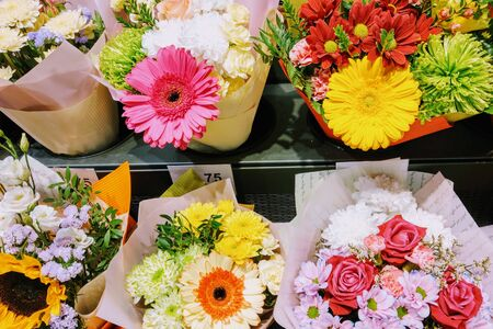 View of a shelf with bouquets of flowers in a flower shop, background