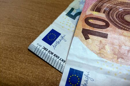 View of the euro bills that lie on the table
