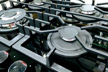 Brand new never used gas stove with stainless tray in appliance retail store Banco de Imagens