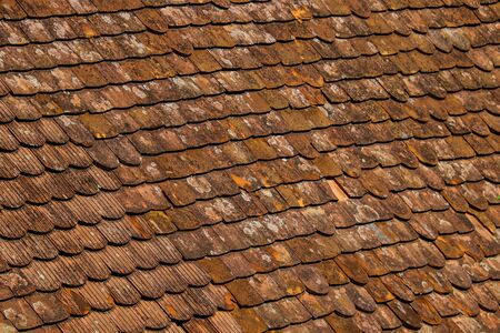 Old and ruined roofs. Texture of a roof with old roof tiles Stok Fotoğraf