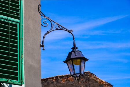 Street lighting concept, lamp, candlestick on blue sky background