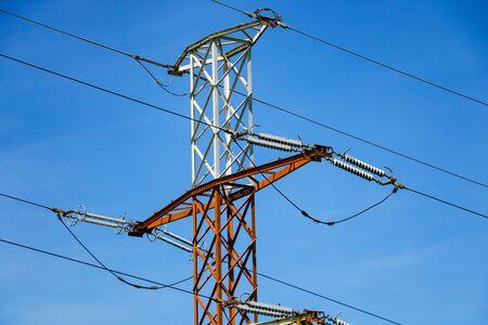 Reliance of high voltage power lines and blue sky Banco de Imagens
