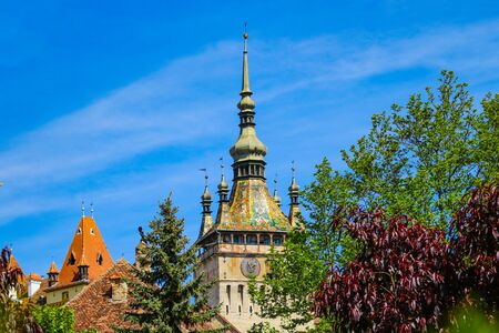 Sighisoara, Romania, May 15, 2019: Citadel Square in Sighisoara. Stunning view of medieval city and Clock Tower built by Saxons, Transylvania, Romania, Europe