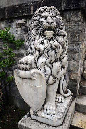 Sinaia, Romania, May 15 2019 Lion sculpture near Peles castle