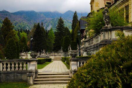 Sinaia, Romania, May 17, 2019: Beautiful Peles castle and ornamental garden in Sinaia landmark of Carpathian mountains in Romania