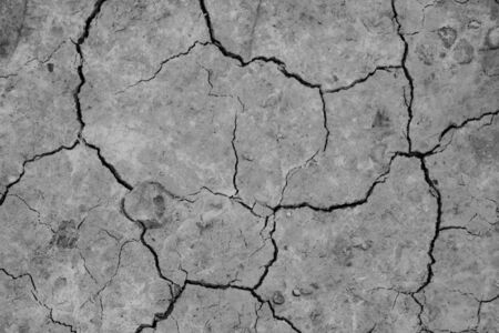 Close-up top view of a cracked part of the earth from a mud volcano, background, out of focus, blank for designers, selective focus