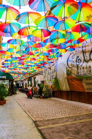 Bucharest, Romania, May 17, 2019: Cafe with colorful umbrellas on a street in Bucharest
