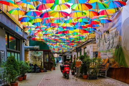 Bucharest, Romania, May 18, 2019: Cafe with colorful umbrellas on a street in Bucharest