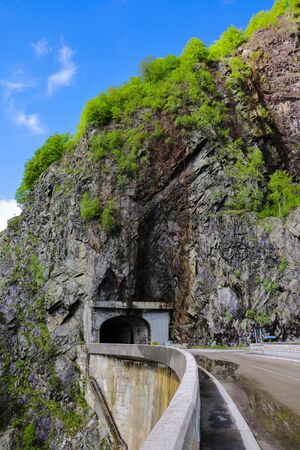 View of the road and the tunnel through the mountain, selective focus 写真素材