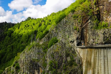 Vidraru Dam is a dam in Romania. It was completed in 1966 on the Arge River and creates Lake Vidraru. The arch dam was built with the primary purpose to produce hydroelectricity 写真素材