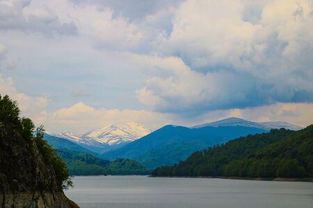 Dam and reservoir on lake Vidraru. Hydropower construction, waterworks Dam Vidrau on Transfagarash highway in Romania