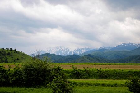 View of the mountain and dark sky during the rain, out of focus 写真素材