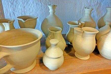 Ceramic products on shelf of potter. Pottery for sale. Ceramic goods on shelf