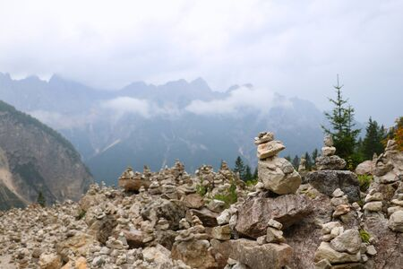 Stone tower made by tourists in mountains