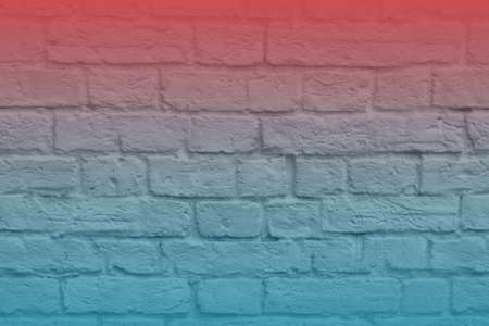 The brick wall of the building is highlighted in red and blue. Background