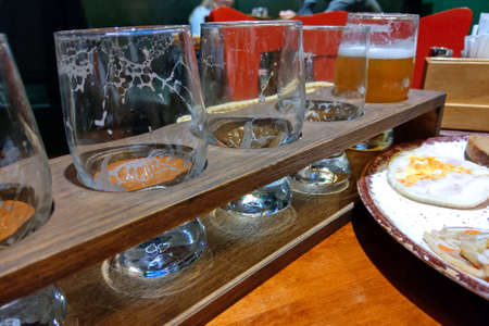 Empty glasses from various kind of beer in a bar