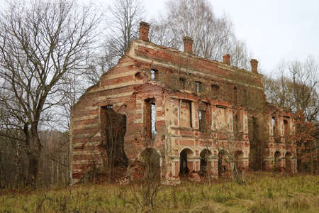 Old ruined red brick building. It's a nasty day. The concept of destruction after the war