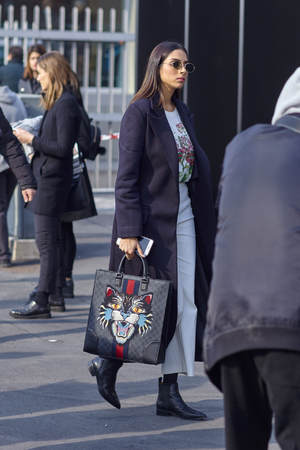 MILAN, ITALY - FEBRUARY 21: A fashionable person is seen outside Gucci during Milan Fashion Week FallWinter 201819 on February 21, 2018 in Milan, Italy.