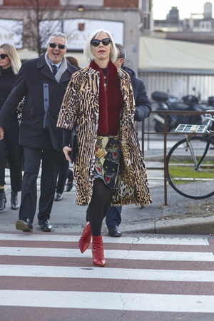MILAN, ITALY - FEBRUARY 21: A fashionable person is seen outside Gucci during Milan Fashion Week FallWinter in Milan, Italy.