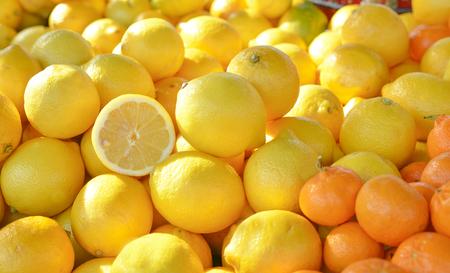 Fresh citrus fruits at a market, lemon and oranges.