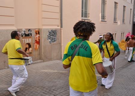 LE MANS, FRANCE - JUNE 13, 2014: Brazilian man dancing at a parade of pilots racing