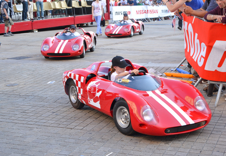 LE MANS, FRANCE - JUNE 13, 2014: Childrens on sports cars on Parade of pilots racing