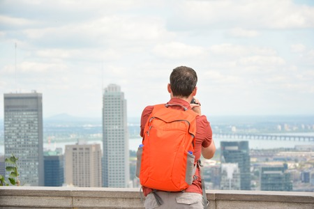 man looking at Montreal downtown skyline cityscape. Canada.