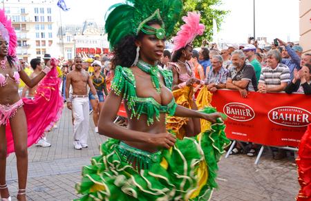LE MANS, FRANCE - JUNE 13, 2014: Brazilian woman dancing samba at a parade of pilots racing. Editorial
