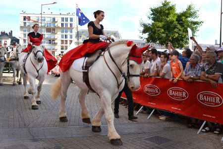 LE MANS, FRANCE - JUNE 13, 2014:White horse with rider.Parade of pilots racing in Le Mans, France