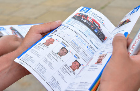 former: LE MANS, FRANCE - JUNE 11, 2017: Brochure with the team of racers of Fabien Barthez - famous former french goalkeeper and racer 11 june 2017- Weighing, administrative and technical checks of the race cars