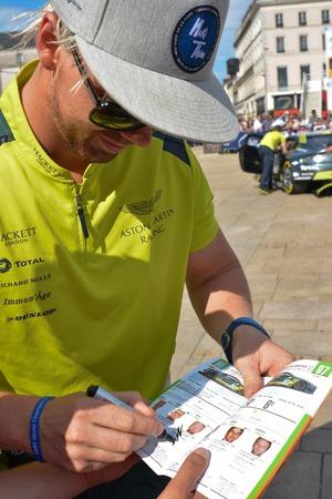 le cap: LE MANS, FRANCE - JUNE 11, 2017: Famous Danish racer Nicki Thiim gives the autograph on his photo Editorial