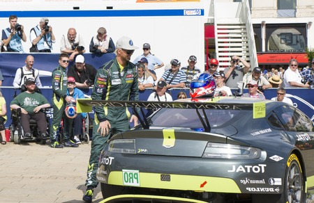 le cap: LE MANS, FRANCE - JUNE 11, 2017: Famous Danish racer Nicki Thiim with his race car Aston Martin. Weighing, administrative and technical checks of the race cars for competition 24 hours of Le mans