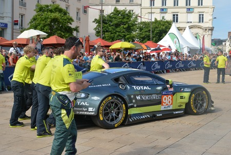 le cap: LE MANS, FRANCE - JUNE 11, 2017: Famous English racer Darren Turner with his team and Aston Martin Vantage racing car. Weighing, administrative and technical checks of the race cars for competition 24 hours of Le mans Editorial