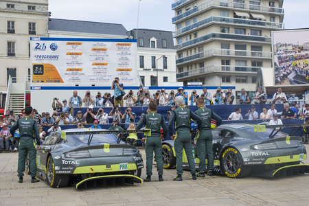 le cap: LE MANS, FRANCE - JUNE 11, 2017: Nicki Thiim Richie Stanaway Marco Sorensen Aston Martin racing team. Weighing, administrative and technical checks of the race cars for competition 24 hours of Le mans
