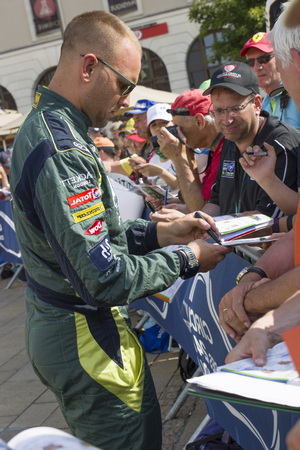 le cap: LE MANS, FRANCE-JUNE 11, 2017: Danish race car driver Marco Sorensen Aston Martin Racing gives autograph Weighing administrative and technical checks of cars for competition 24 hours of Le mans Editorial