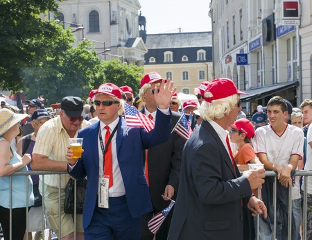 le cap: LE MANS, FRANCE - JUNE 16, 2017: Men in the parade of pilots in Le Mans with beer disguised as Donald Trump