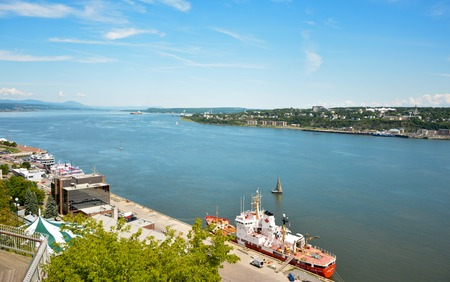 QUEBEC, CANADA - AUGUST 20, 2014: Fishing red boat View from above at a river Saint Lawrence Editorial