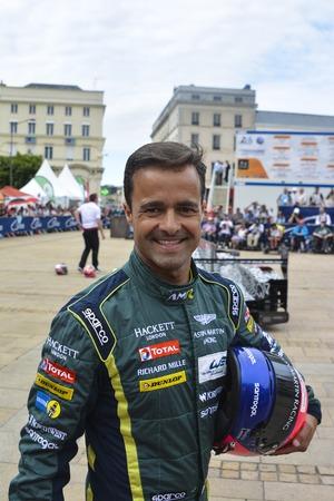 le cap: LE MANS, FRANCE - JUNE 11, 2017: Portuguese race car driver Pedro Lamy Aston Martin Racing during parade of pilots racing Editorial