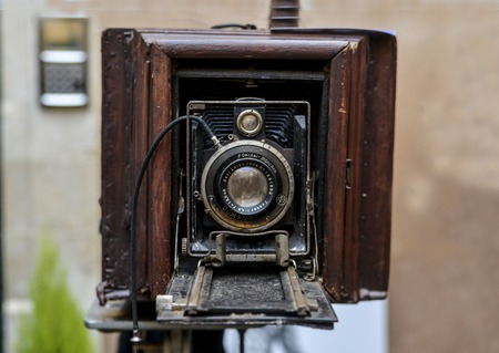 LE MANS, FRANCE - OCTOBER 02, 2016: Old big vintage camera of wood and metal close on the street of France
