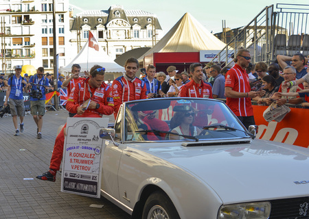 LE MANS, FRANCE - JUNE 16, 2017: Vitaly Petrov russian pilot racer with his team Oreca 07 Gibson 25 on a parade of pilots racing in Le mans,France Editorial