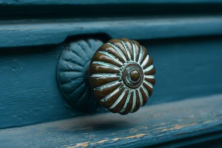 Closeup of blue turquoise old textured antique door with door handle Stock Photo