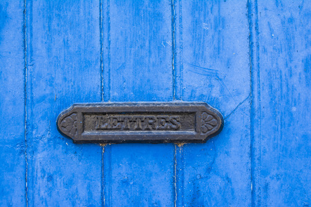 blue shabby door with french vintage mailbox