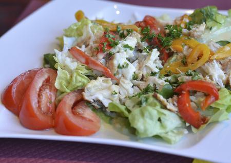 salad with fish green salad rice and tomatos Stock Photo