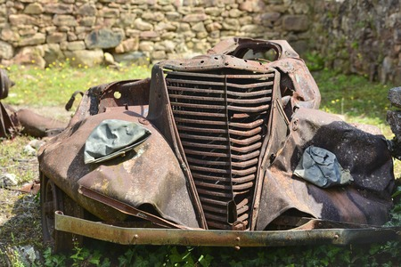 Destroyed cars during World War 2 in Oradour sur Glane Stock Photo