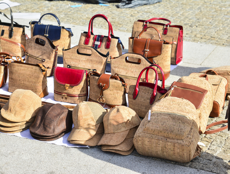 Variety of bags and souvenirs made from oak cork at the street market at Lisbon, Portugal. Porto