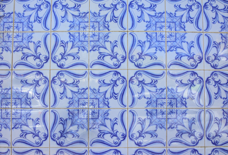Typical old tiles of Portugal, detail of a classic ceramic tiles azulejo, art of Portugal