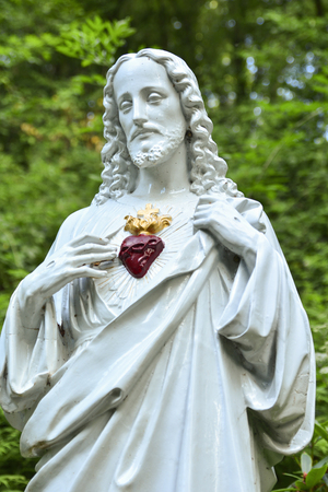 Statue of Jesus with a red heart