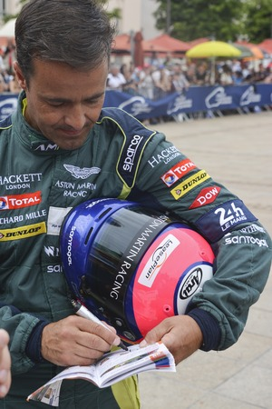 LE MANS, FRANCE - JUNE 11, 2017: Portuguese race car driver Pedro Lamy Aston Martin Racing in the uniform gives autograph during parade of pilots racing at Le mans,France