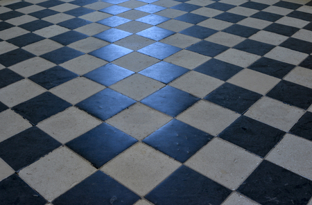 Checkerboard pattern on a stone floor. Stock Photo